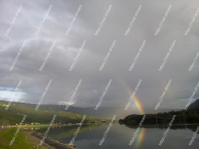 Image of Sky, Rainbow, Highland, Cloud, Loch, Water, Atmospheric phenomenon, Natural landscape, Lake, Reservoir