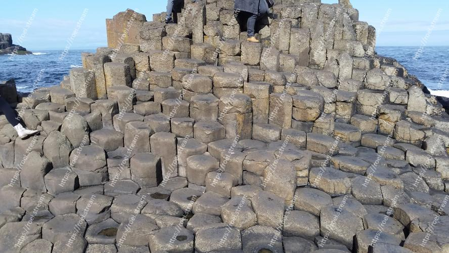 The Giant Causeway rocks. Image of Rock, Wall, Formation, Ruins, Geology, Stone wall, Historic site, Sea, Bedrock, Coast