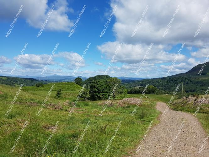 Natural landscape, Sky, Highland, Nature, Grassland, Mountainous landforms, Vegetation, Hill, Natural environment, Wilderness2. Image of Natural landscape, Sky, Highland, Nature, Grassland, Mountainous landforms, Vegetation, Hill, Natural environment, Wilderness