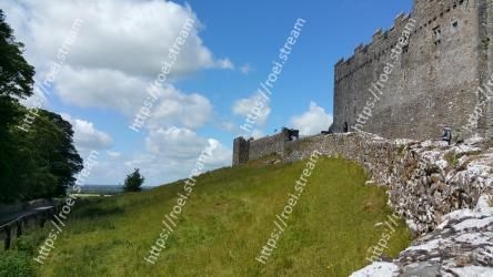 Ruins,Castle,Wall,Fortification,Sky,Grass,Highland,Building,Tree,Mountain