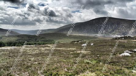 Highland,Mountainous landforms,Mountain,Hill,Nature,Natural landscape,Grassland,Sky,Natural environment,Fell