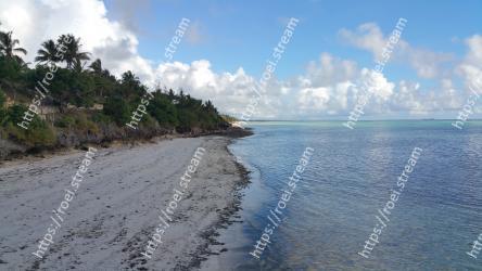 Body of water,Shore,Sea,Beach,Sky,Coast,Ocean,Tropics,Coastal and oceanic landforms,Cloud