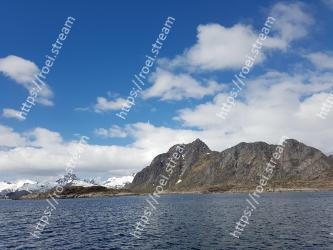 Sky, Body of water, Mountain, Mountainous landforms, Sea, Cloud, Blue, Water, Highland, Sound