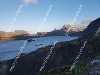 Mountainous landforms,Highland,Mountain,Mountain range,Wilderness,Tarn,Fell,Sky,Loch,Fjord