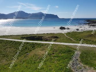 Body of water,Coast,Sea,Beach,Shore,Headland,Ocean,Sky,Coastal and oceanic landforms,Natural environment