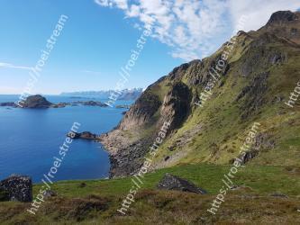 Body of water, Highland, Coast, Sky, Headland, Mountain, Sea, Mountainous landforms, Cliff, Coastal and oceanic landforms