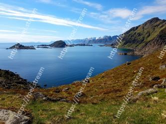 Body of water, Coast, Mountain, Highland, Natural landscape, Mountainous landforms, Sky, Headland, Sea, Coastal and oceanic landforms