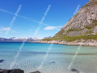 Body of water,Coast,Sky,Sea,Natural landscape,Water,Blue,Mountain,Coastal and oceanic landforms,Shore