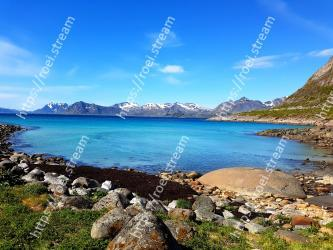 Body of water,Natural landscape,Sky,Coast,Nature,Mountain,Water,Sea,Shore,Mountainous landforms