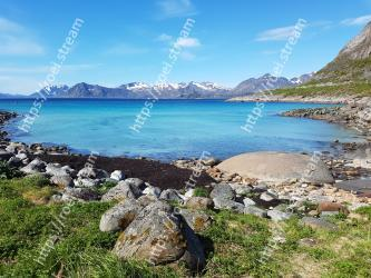Body of water,Natural landscape,Mountain,Mountainous landforms,Coast,Sky,Wilderness,Water,Shore,Sea