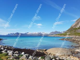 Body of water,Coast,Sky,Sea,Natural landscape,Blue,Mountain,Water,Shore,Coastal and oceanic landforms