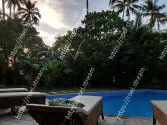 Property,Resort,Tree,Sky,Palm tree,Swimming pool,Leisure,Real estate,House,Arecales