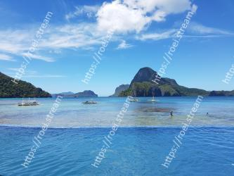 Body of water,Sky,Sea,Ocean,Blue,Coastal and oceanic landforms,Coast,Water,Tropics,Beach