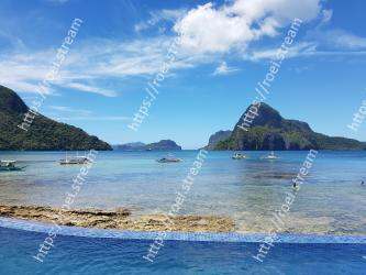Body of water,Sky,Sea,Natural landscape,Water,Ocean,Coast,Coastal and oceanic landforms,Blue,Tropics