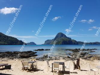 Sky,Sea,Beach,Natural landscape,Coast,Ocean,Tourism,Mountain,Tropics,Coastal and oceanic landforms Cadlao Resort & Restaurant