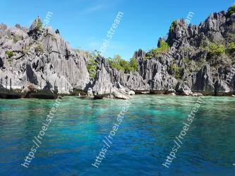 Body of water, Sea, Natural landscape, Coastal and oceanic landforms, Coast, Rock, Bay, Sky, Promontory, Turquoise