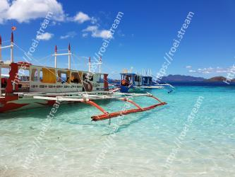 Sky,Blue,Water,Boat,Vacation,Water transportation,Sea,Beach,Ocean,Tourism