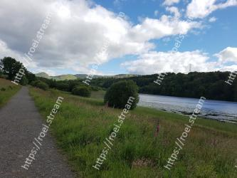 Natural landscape,Sky,Nature,Cloud,Highland,Natural environment,River,Grass,Reservoir,Tree