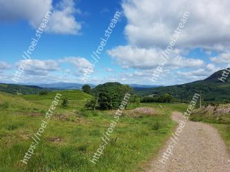Natural landscape,Sky,Highland,Nature,Grassland,Mountainous landforms,Vegetation,Hill,Natural environment,Wilderness