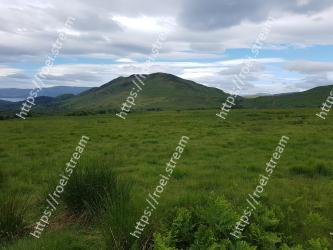 Mountainous landforms,Highland,Grassland,Hill,Mountain,Natural environment,Vegetation,Natural landscape,Pasture,Wilderness