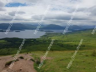 Highland,Mountainous landforms,Sky,Mountain,Wilderness,Grassland,Hill,Loch,Natural environment,Fell Loch Lomond