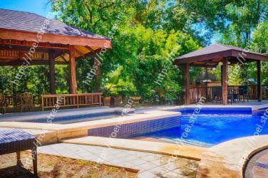 Property, Swimming pool, Real estate, Leisure, Home, Backyard, Tree, Patio, Building, House