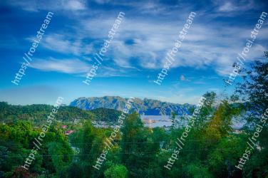 Sky,Nature,Natural landscape,Mountainous landforms,Blue,Mountain,Green,Cloud,Vegetation,Hill station