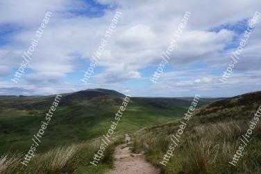 Highland, Mountainous landforms, Hill, Grassland, Sky, Mountain, Fell, Natural landscape, Wilderness, Grass