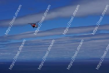 Helicopter, Rotorcraft, Sky, Aircraft, Vehicle, Helicopter rotor, Cloud, Ocean, Flight, Aviation