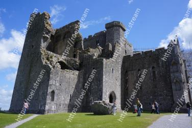 Ruins,Ancient history,Castle,Historic site,Archaeological site,Building,History,Sky,Rock,Grass Rock of Cashel