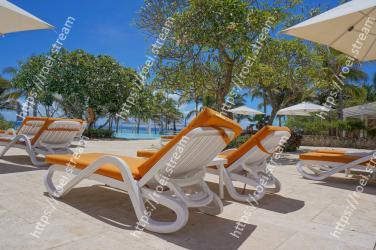 Outdoor furniture, Sunlounger, Furniture, Vacation, Resort, Leisure, Chaise longue, Caribbean, Tree, Shade
