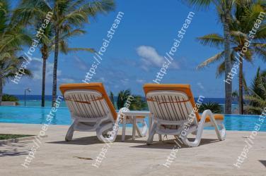 Outdoor furniture, Furniture, Vacation, Tree, Sunlounger, Beach, Property, Caribbean, Tropics, Leisure