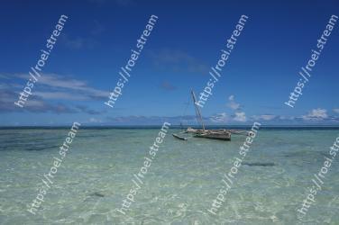 Body of water, Sea, Sky, Ocean, Beach, Boat, Water, Tropics, Vehicle, Coastal and oceanic landforms