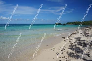 Body of water, Beach, Sea, Shore, Sky, Ocean, Tropics, Water, Coast, Blue