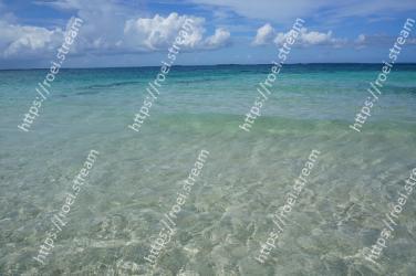 Body of water, Sea, Ocean, Beach, Shore, Sky, Turquoise, Caribbean, Tropics, Aqua