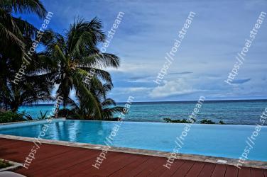 Swimming pool, Resort, Property, Vacation, Tropics, Caribbean, Sky, Ocean, Sea, Tree
