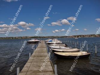 Water transportation, Sky, Water, Dock, Pier, Boat, Daytime, Sea, Cloud, Vehicle