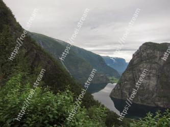 Mountainous landforms, Highland, Mountain, Fjord, Natural landscape, Wilderness, Valley, Sky, Cliff, Water Aurland
