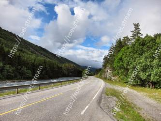 Road, Highland, Sky, Asphalt, Cloud, Natural landscape, Mountainous landforms, Highway, Mountain, Thoroughfare