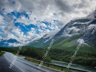 Mountainous landforms, Highland, Mountain, Road, Sky, Natural landscape, Nature, Cloud, Mountain range, Mountain pass