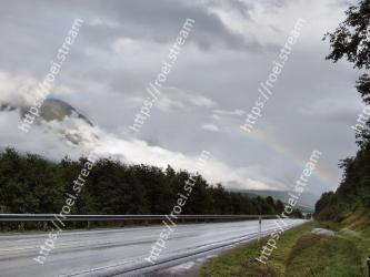 Sky, Cloud, Rainbow, Road, Natural landscape, Meteorological phenomenon, Highway, Highland, Atmospheric phenomenon, Tree