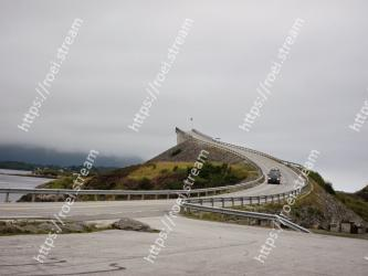 Sky, Atmospheric phenomenon, Road, Wall, Sea, Infrastructure, Cloud, Highland, Hill, Tree