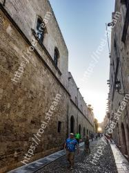 People,Wall,Street,Town,Sky,Architecture,Cobblestone,Neighbourhood,Road,Urban area Medieval City of Rhodes